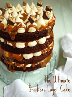 The Ultimate Snickers Layer Cake - Light, airy sponge cake, sandwiched with peanut butter, marshmallow icing and homemade caramel.