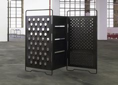 Paravent by Mona Hatoum (UK) - Based on a fold-out cheese grater scaled up to the size of a room divider or screen giving it surreal and architectural