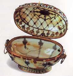 the seventeenth-century box by Le Roy...    Carved from a block of milky chalcedony, this egg, mounted on a gold enameled base, was closely modeled after an eighteenth century casket by Le Roy, now located in Dresden at the Grüne Gewölbe Museum.