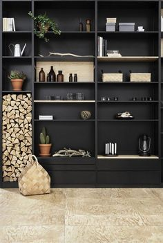 Wonderful black shelving unit styling - love the use of the fire wood…
