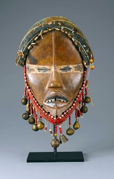 Africa | Mask from the Dan people of the Ivory Coast or Liberia | Wood, fiber, brass bells, metal and beads