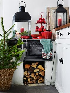 scandinavian holiday kitchen: white with black cook stove and red candles, apples, and dishes