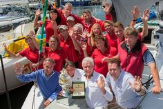 Roger Hickman, Owner Wild Rose, and crew receive the Tattersall's Cup and a Rolex Timepiece. Front row: Jean-Nöel Bioul, Rolex SA, John Cameron, Commodore Cruising Yacht Club of Australia, Roger Hickman, Richard Batt,  Commodore Royal Yacht Club of Tasmania.