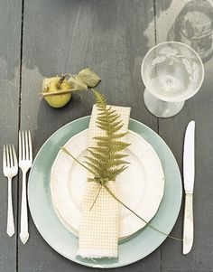Fern Table Setting:     Mismatched silverware and china still look sophisticated with natural embellishments, like a hand-picked fern frond. Even when dining outdoors, if your table's surface is in good shape, like this one, you can forgo a tablecloth.