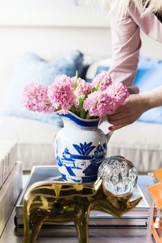 Arrange fresh flowers in a blue & white vase on your coffee table