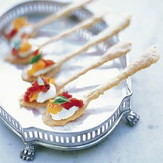 Creamy Goat Cheese with Sun-dried Tomatoes on a Crispy Spoon-Shaped Cracker. <3