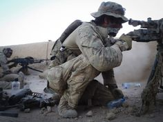 Australian soldiers from the Special Operations Task Group monitor activity from an overwatch position as force elements clear a compound nearby, in Helmand province, southern Afghanistan.