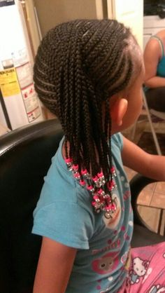 Kiddie cornrows with beads by Rilbraidz Braidery