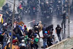 National Guard using a gun during a protest today in Venezuela