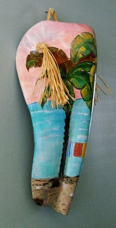 Wall Decor from a Queen Palm frond boot. This piece is completely hand painted with acrylics. The measurements are 19.5 x 15.5 with a 5 depth. This piece is clear coated for protection and ready to display