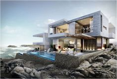Las Palmeras is a breathtaking project by Greg Wright Architects. These 2 holiday houses on the coastline of Peru which sit prominently at the top of a rock cliff overlooking the beach and ocean, are anchored into the rock with a stone sculptural plinth rising up to the living levels, concealing a basement floor below