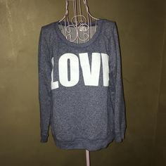 Victoria's Secret Sweatshirt Writing says LOVE. 88% cotton, 12% polyester. Runs on the shorter side and is fairly thin material. Victoria's Secret Tops Sweatshirts & Hoodies