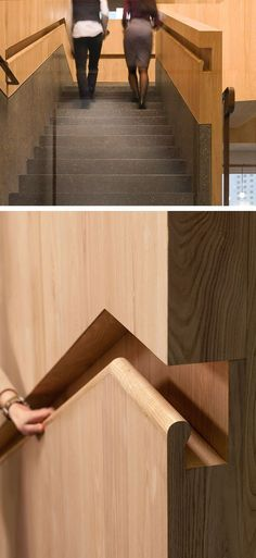 Stair Design Idea - 9 Examples Of Built-In Handrails | This office in Hong Kong transitions from brass handrails into built-in wooden handrails.