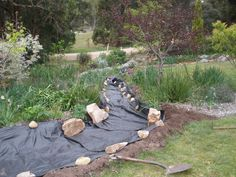 Dry creek bed...laying foundational tarp/mesh.