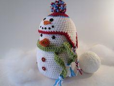 Crochet Snowman with Snowman Hat Cutie, Winter Decoration, Stuffed Snowman, Centerpiece by CROriginals. $35.00, via Etsy.