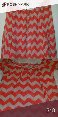 Voll Chevron Blouse Voll Chevron sheer Blouse with orange & tan stripes. Draped elastic neckline. Gathered at elbow with big flare at the sleeve. Should be worn with solid tan colored cami for the SEXIEST results. Can be worn off both shoulders or just one. Blouse comes just below the hips. * 100% Polyester/Sheer * Worn only a couple of times * Wash gently and air dry  * ZERO Flaws * Pet and smoke free home Voll Tops Blouses