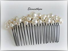 Bridal comb pearl Hair Accessories Wedding hair piece Swarovski white or ivory pearls Beaded Black comb Veil attachment Tiara Fascinator. $26.00, via Etsy.