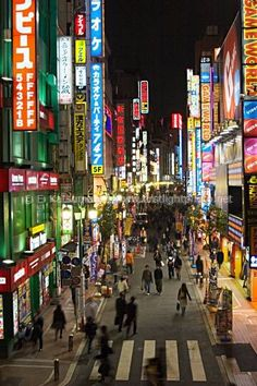 Signs light up the Shinjuku district at night, Tokyo, Japan
