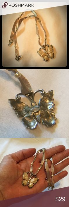 Silk Butterfly choker by Gerard Yosca The Butterfly is a symbol of transformation, hope and joy.  Authentic Gerard Yosca pearlized butterfly with Swarovski Crystal and fresh water pearl accents on a silk cord also accented with fresh water pearls.  Excellent condition.  This is a choker so the butterfly sits just below the throat. Yosca Jewelry Necklaces