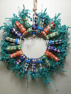 Could be created easily with an embroidery hoop, finger traps, bagels, crinkle paper. Can be used a foraging toy, too!