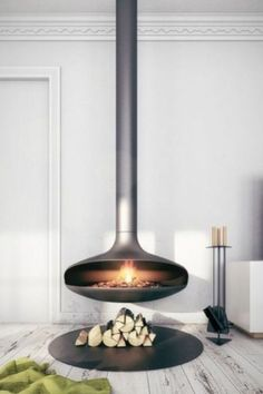 """42 Lovely Scandinavian Fireplace To Rock This Year. A stone fireplace design your pioneer ancestors would envy is the """"Multifunctional Fireplace."""" The hearth is built up high to create a storage a. Suspended Fireplace, Hanging Fireplace, Stove Fireplace, Freestanding Fireplace, Wood Fireplace, Indoor Gas Fireplace, Floating Fireplace, Electric Fireplace, Scandinavian Fireplace"""