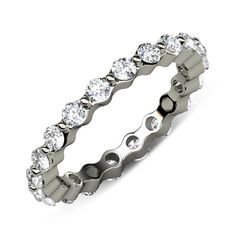 This is a beautiful 1.50cttw Floating Diamond Eternity Band With April Birthstone Natural White Round Diamond in 14K White Gold, representing Love.