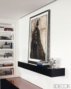Ralph Lauren's abode in New York. I love how there's an entire shelf dedicated to a piece of art!