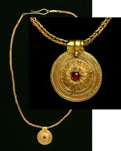 Greece. Hellenistic Gold Necklace with Pendant. Circa late 4th-3rd Centuries B.C. A loop-in-loop chain beautifully displays the disk pendant with a cabochon garnet centrally set within a shield-like convexity. A similar necklace can be found and described inCatalogue of the Jewellery, Greek, Etuscan, and Roman, in the Departments of Antiquities, British Museum, by Marshall, #2062. 18 1/4 in. (46.4 cm. in length). Weight: 15.1 grams.