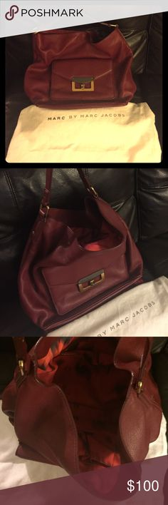 FLASH SALE* Marc by Marc Jacobs hand bag Authentic Red/maroon bag with front buckled pocket gently used with dust bag; no signs of wear or tear- the real leather is durable! Pictures are taken with stuffing inside the bag (it's really roomie!) Marc by Marc Jacobs Bags Hobos