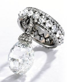Jayne Wrightsman ,Platinum and Briolette Diamond Ring, JAR, Paris  $566,500.00 The briolette diamond weighing 10.28 carats, suspended from a band set with 20 rose-cut and numerous single-cut diamonds.