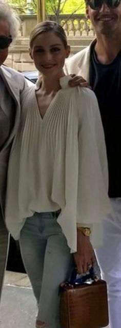Who made Olivia Palermo's white pleated top, brown handbag, and ripped blue skinny jeans?