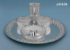 Pure Silver Dinner Set for a single person. Includes 1 Plate, 1 Glass, 2 small dish bowls, 1 sweet dish bowl, 1 fork, 1 spoon.