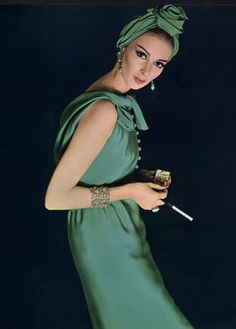 1960's Dior Photo, moving from the 50's to sixties the skirts became more fitted and the skirts shortened