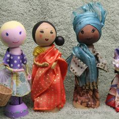 Clothespeg dolls in saree, kimono, gele, bubo and irk, and contemporary dress. The tutorial that follows will show you the basic steps for making a doll, along with a range of easy ways to make facial features and hair styles for your dolls. The doll's shown here have been made as decorations for Mother's Day, and feature various ethnic groups and costumes to represent mother's from around the world.