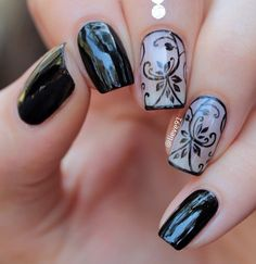Black and white floral nail art design. Paint on your favorite flowers in black polish by using a white base coat. It looks clean and always trendy.