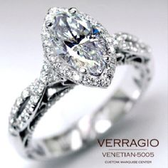 Stunning, twisted pave band, with a marquis cut diamond surrounded by halo.