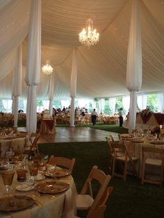 Tent with Crystal Chandeliers, tent liner, and custom center pole drapery