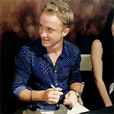 Tom Felton at the East Japan Earthquake charity sign (July, 19) gif