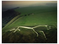 The White Horse of Uffington, which lies close to The Ridgeway path, is thought to be the oldest hill figure in Britain. Carved out into the chalk escarpment, the horse measures 374 feet in length, and is thought to date back to 1000BC in the late Bronze Age. It is huge, and it's an atmospheric place to visit. Oxfordshire.