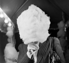 24hoursinthelifeofawoman:  UNKNOWN WOMAN EATING COTTON CANDY...