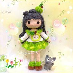 Amigurumi doll in an apple dress with her tiny crochet kitten. (Inspiration).