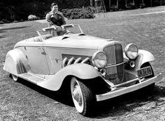 San Fernando Valley resident Clark Gable shows off his Duesenberg. — at San Fernando Valley.