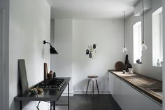 In Jonas Bjerre-Poulsen's home (you might recognize Bjerre-Poulsen as the photographer of this Danish house, which was featured in Dwell's April 2012 issue), white walls and cabinets allow details, like the herringbone worksurface crafted from reclaimed wood and lighting fixtures, to shine.