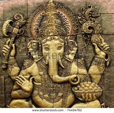 stock-photo-the-indian-god-ganesha-made-from-clay-in-low-relief-carving-jig-saw-image-style-74494762