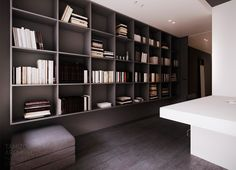 A void under the bookcase keeps the room spacious - flat interior design, warsaw.