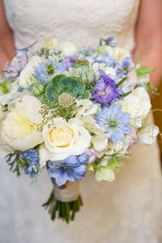 blue and white wedding bouquet by Laughin' Gal Floral... With near impossible to find flowers... Love in a mist!?