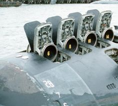 The hatches of the 12 vertical-launch Tomahawk missile tubes stand open on the bow of the nuclear-powered attack submarine USS OKLAHOMA CITY (SSN-723), 02/01/1991