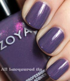 Zoya Lotus polish- smoked-out, deep violet sprinkled with magenta metallic flecks.