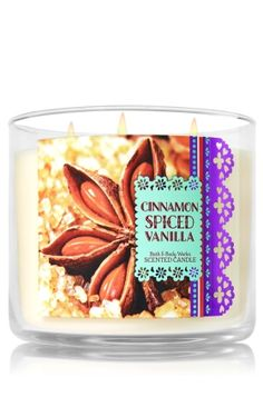 "Cinnamon Spiced Vanilla - 3-Wick Candle - Bath & Body Works - The Perfect 3-Wick Candle! Made using the highest concentration of fragrance oils, an exclusive blend of vegetable wax and wicks that won't burn out, our candles melt consistently & evenly, radiating enough fragrance to fill an entire room. Topped with a flame-extinguishing lid! Burns approximately 25 - 45 hours and measures 4"" wide x 3 1/2"" tall."