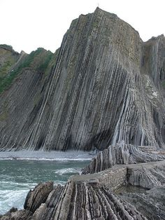 Itzurun beach, Zumaia, Spain, is of special interest to geologists because it is situated among the longest set of continuous rock strata in the world. Known locally as the 'flysch' they date from the mid-cretaceous period to present, a time period of over 100 million yrs.Tthe K-T boundary is present at the Itzurun beach, & fossils can be found, notably of ammonites